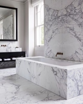 Nice and minimalist bathroom with the glass wall with a concrete 13