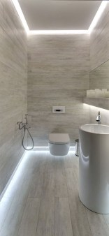Nice and minimalist bathroom with the glass wall with a concrete 14