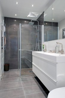 Nice and minimalist bathroom with the glass wall with a concrete 21