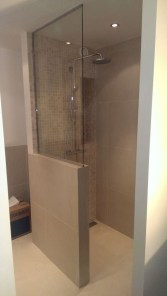 Nice and minimalist bathroom with the glass wall with a concrete 29