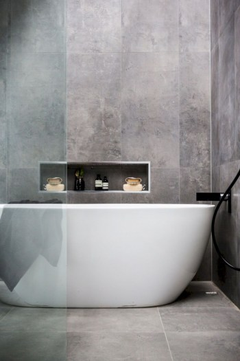 Nice and minimalist bathroom with the glass wall with a concrete 35