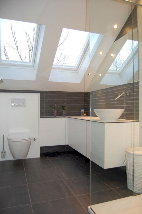Nice and minimalist bathroom with the glass wall with a concrete 42