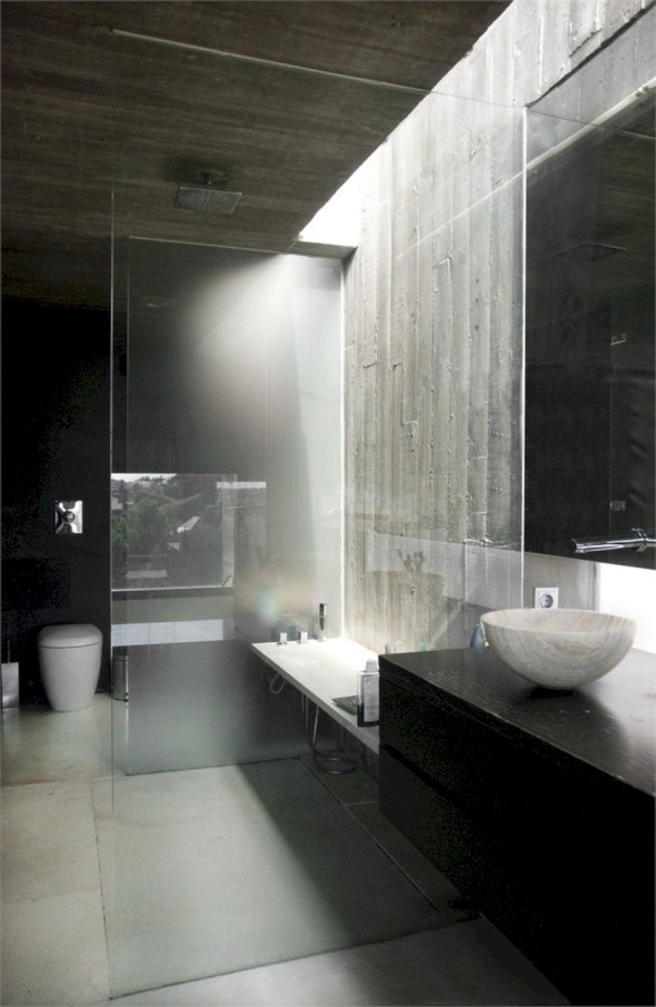Nice and minimalist bathroom with the glass wall with a concrete 43
