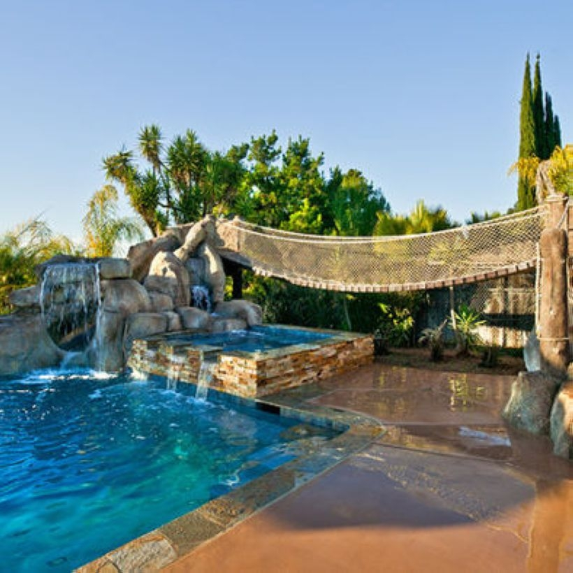 Pool waterfalls ideas for your outdoor space 08