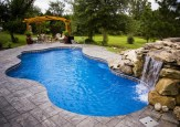 Pool waterfalls ideas for your outdoor space 09