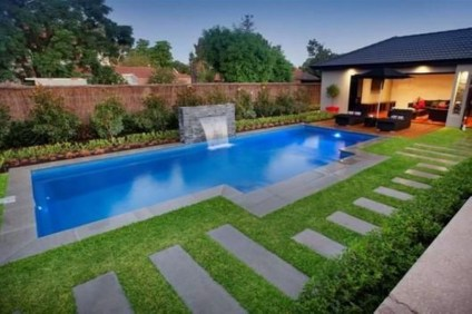 Pool waterfalls ideas for your outdoor space 15