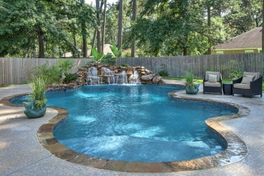 Pool waterfalls ideas for your outdoor space 17