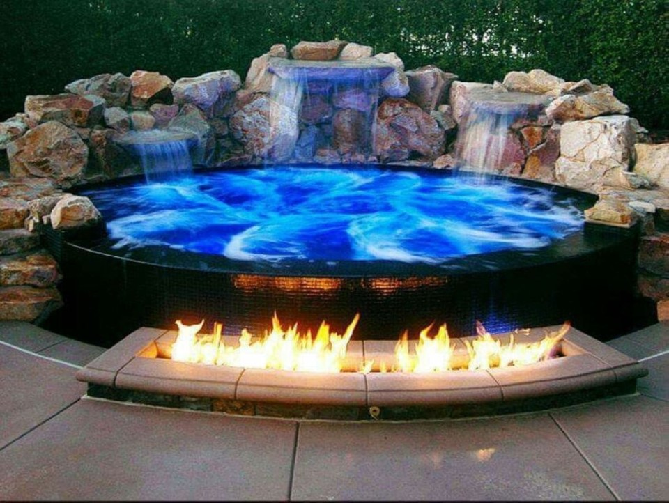 Pool waterfalls ideas for your outdoor space 23
