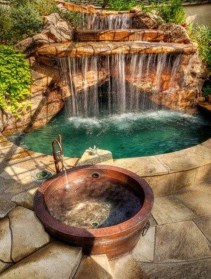 Pool waterfalls ideas for your outdoor space 25