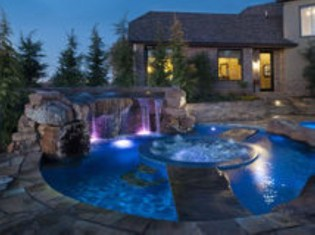 Pool waterfalls ideas for your outdoor space 29