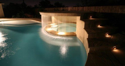 Pool waterfalls ideas for your outdoor space 31