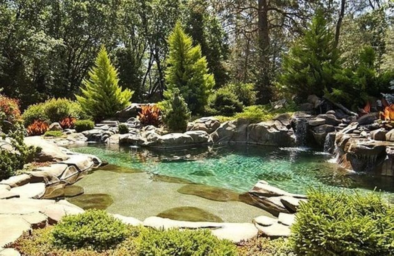 Pool waterfalls ideas for your outdoor space 35