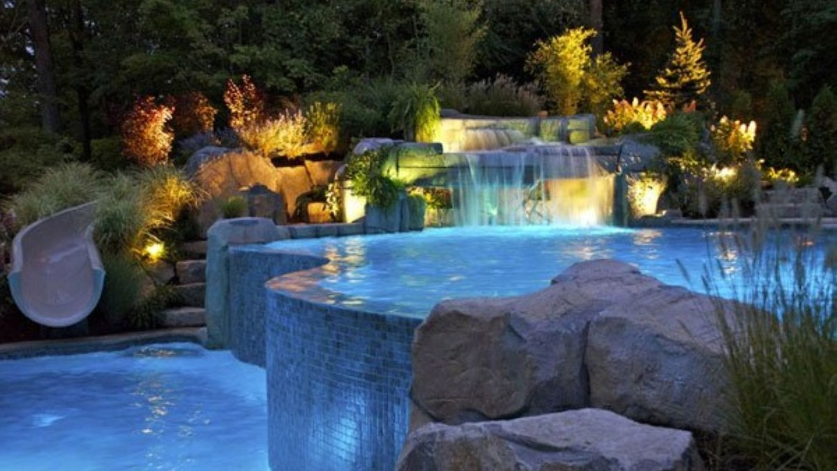39 Pool Waterfalls Ideas for Your Outdoor Space