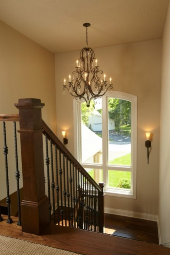 Ways to decorate with chandelier over the stairs 24