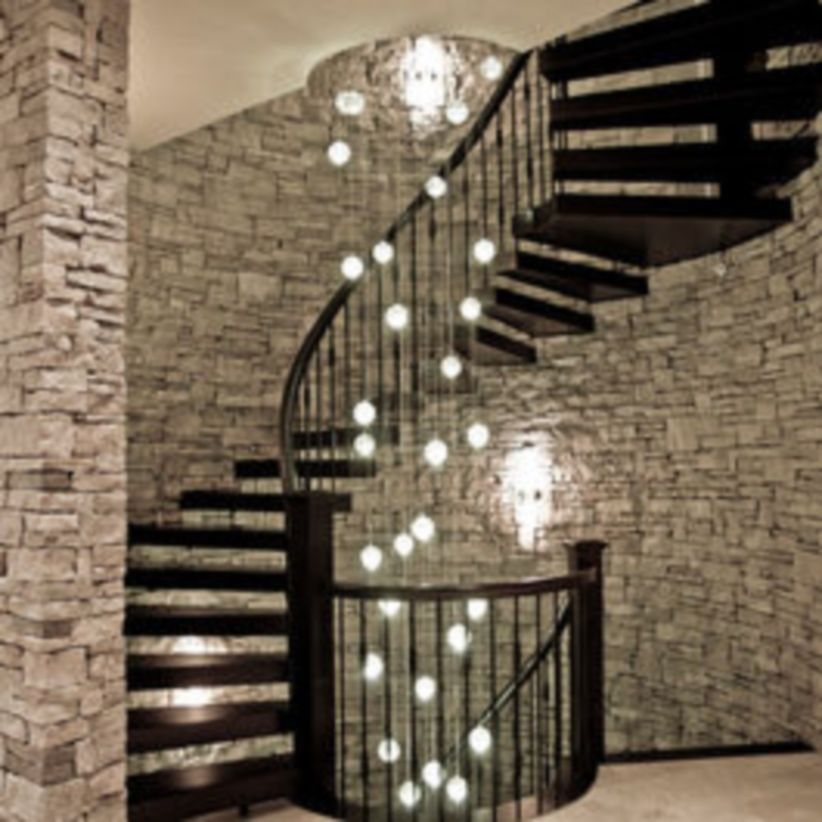 Ways to decorate with chandelier over the stairs 26