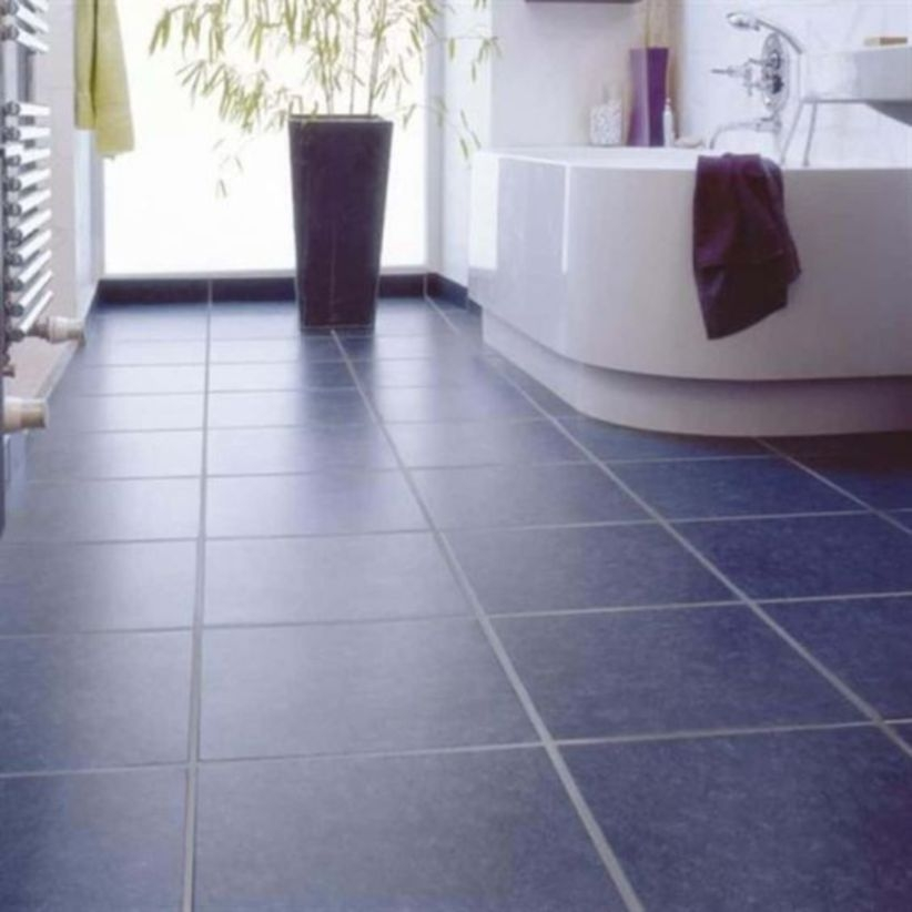 Bathroom with navy floor tiles
