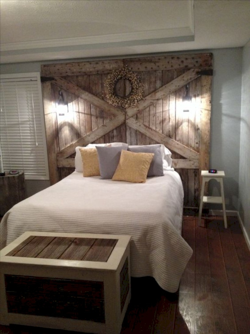 Bedroom with barn wood headboard and lights