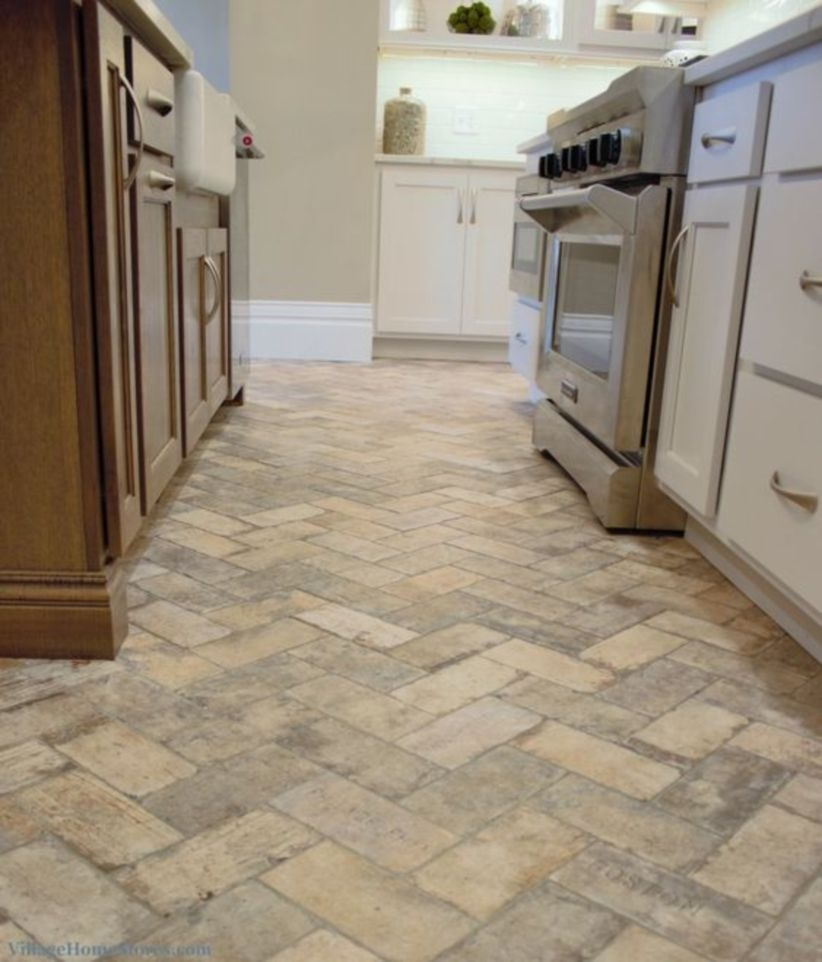 Brick tiled flooring installed in a remodeled historic kitchen