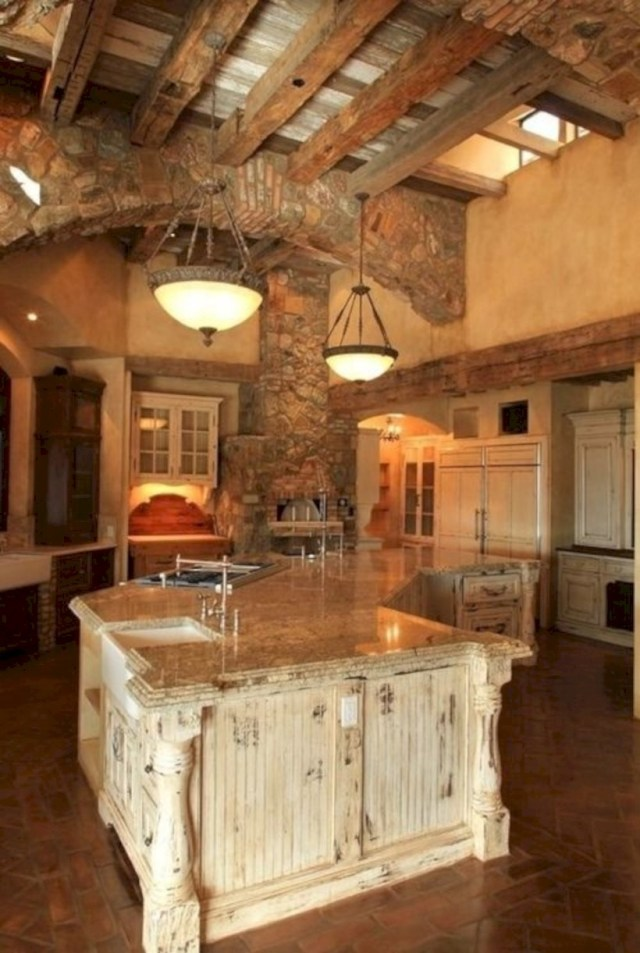 High ceilinged rustic kitchen with stone