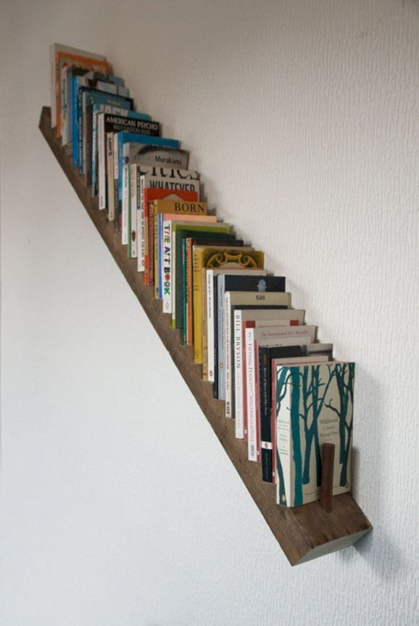Store books under stairs