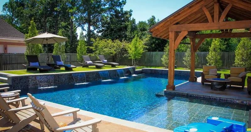 2. combination pool and stone waterfall in backyard