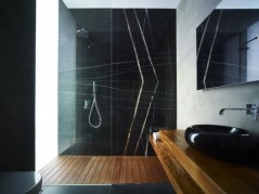 Elegant bathroom design with black walls 11