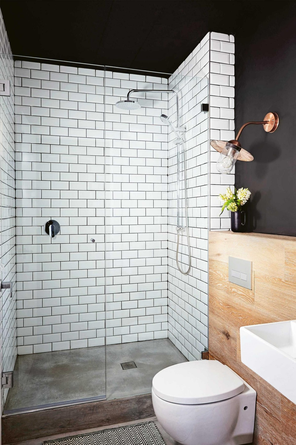 Elegant bathroom design with black walls 14