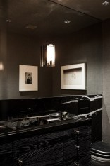 Elegant bathroom design with black walls 17
