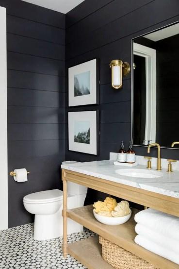 Elegant bathroom design with black walls 21