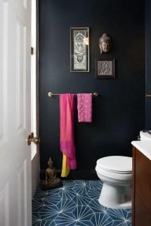Elegant bathroom design with black walls 28