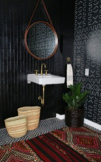 Elegant bathroom design with black walls 31