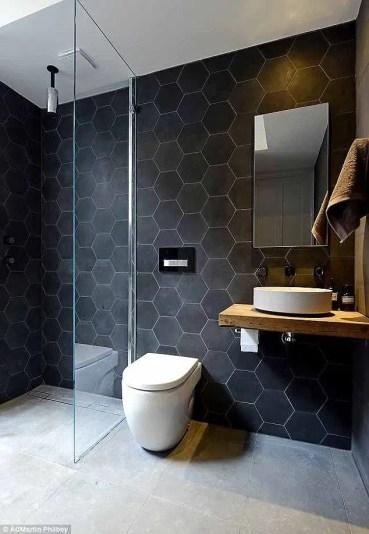 Elegant bathroom design with black walls 34