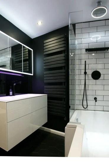 Elegant bathroom design with black walls 38