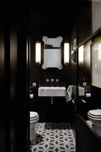 Elegant bathroom design with black walls 44