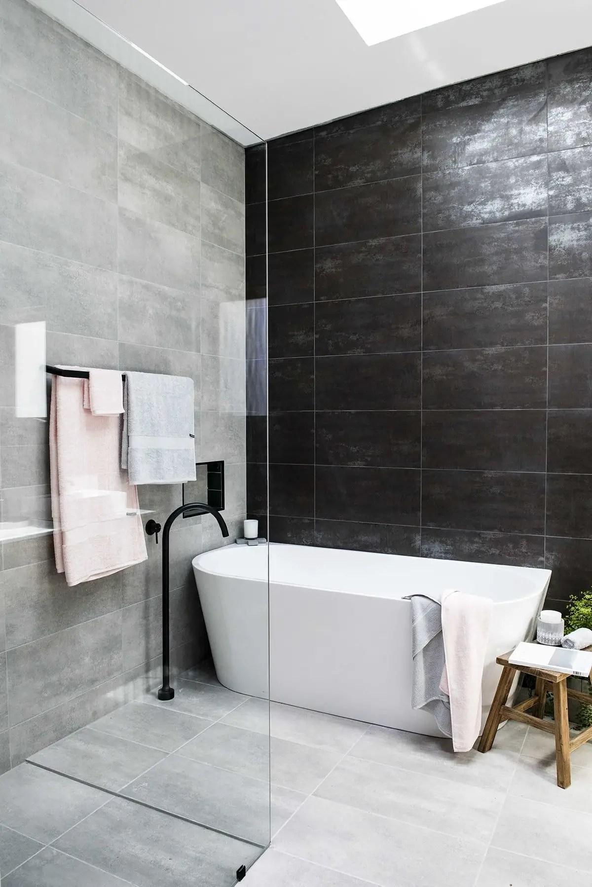 Elegant bathroom design with black walls 47