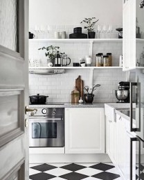 Stylist and elegant black and white kitchen ideas 19
