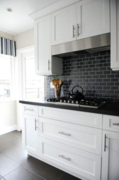 Stylist and elegant black and white kitchen ideas 31