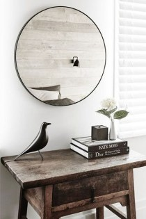 Adorable round mirror designs to brighten up your small space 13