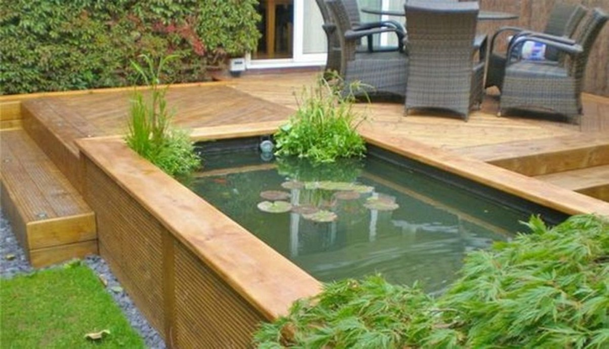 Design a fish pond garden with a waterfall concept 02