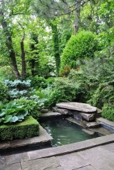 Design a fish pond garden with a waterfall concept 05