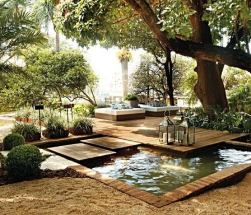 Design a fish pond garden with a waterfall concept 15