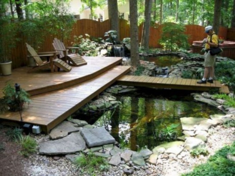 Design a fish pond garden with a waterfall concept 26