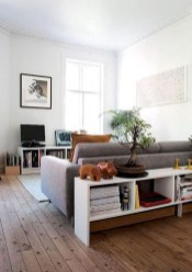 Design a living room in a small space that remains comfortablel 01