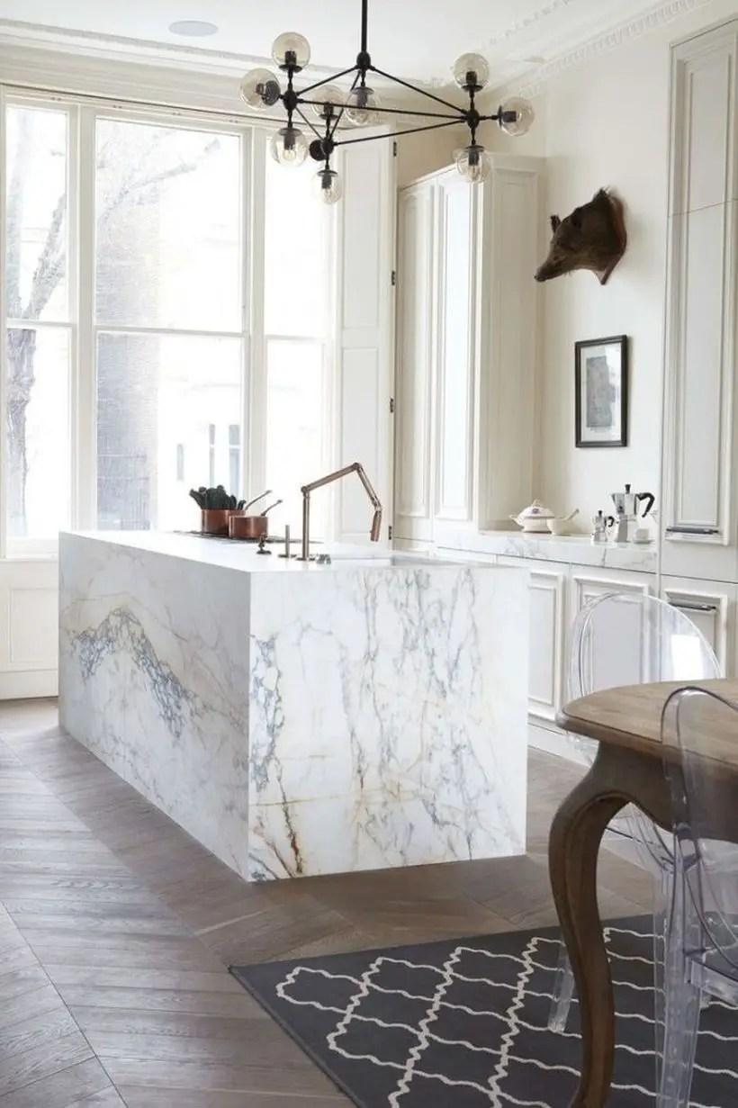 Best white kitchen with white kitchen island table, white walls, large white windows that make it bright