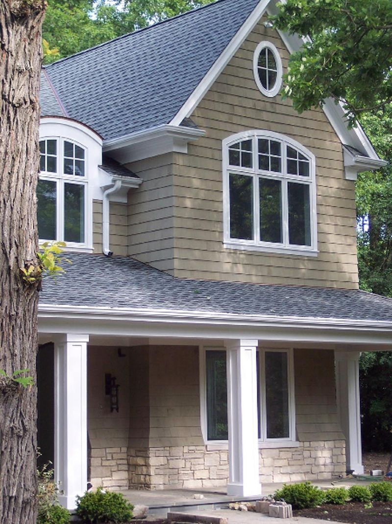 Classic exterior design with grey walls, light grey roof and white windows to decorate your classic home