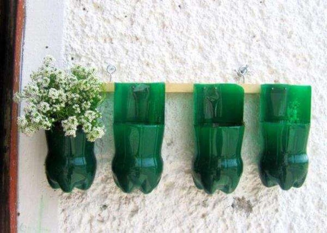 Easy diy plastic flower pot from bottle on the wall with green