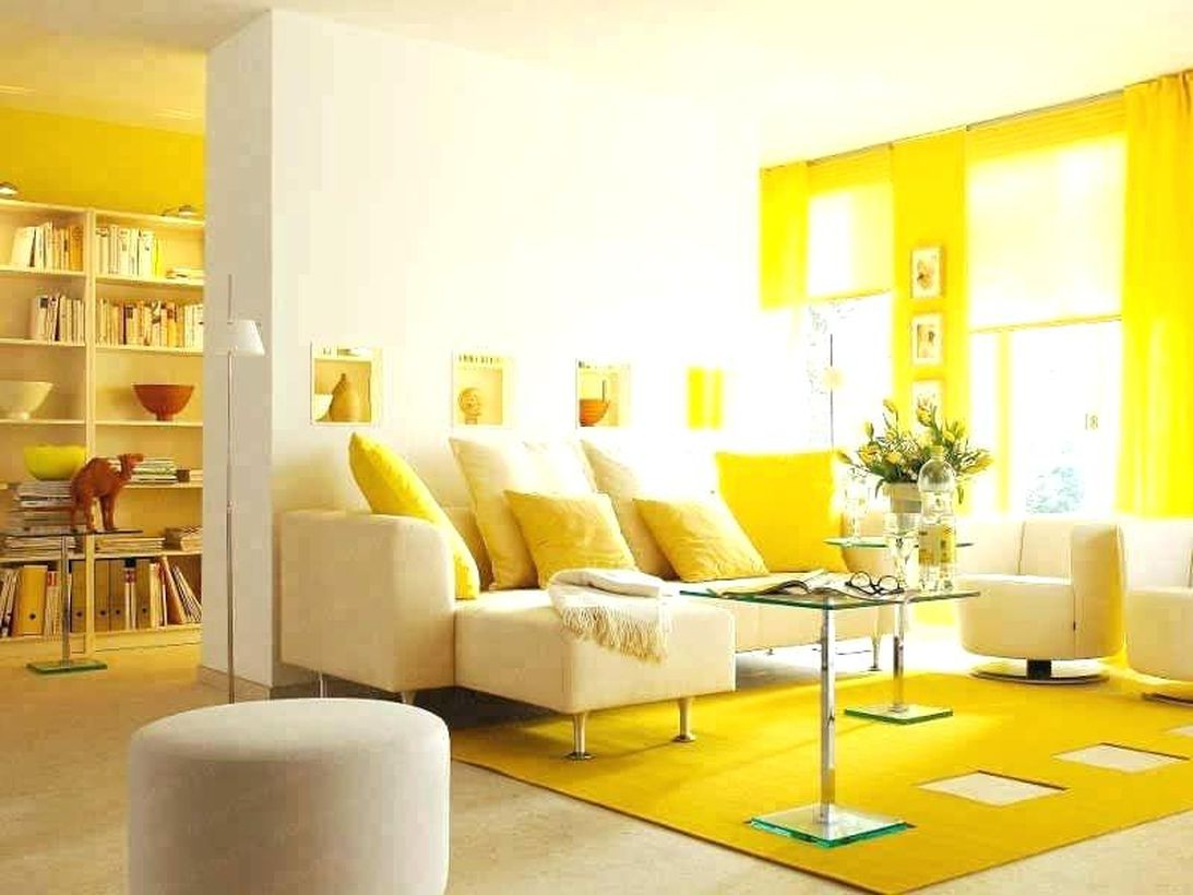 Gorgeous yellow living room with yellow carpet, yellow curtains, yellow pillows, brown sofa, small table, big window