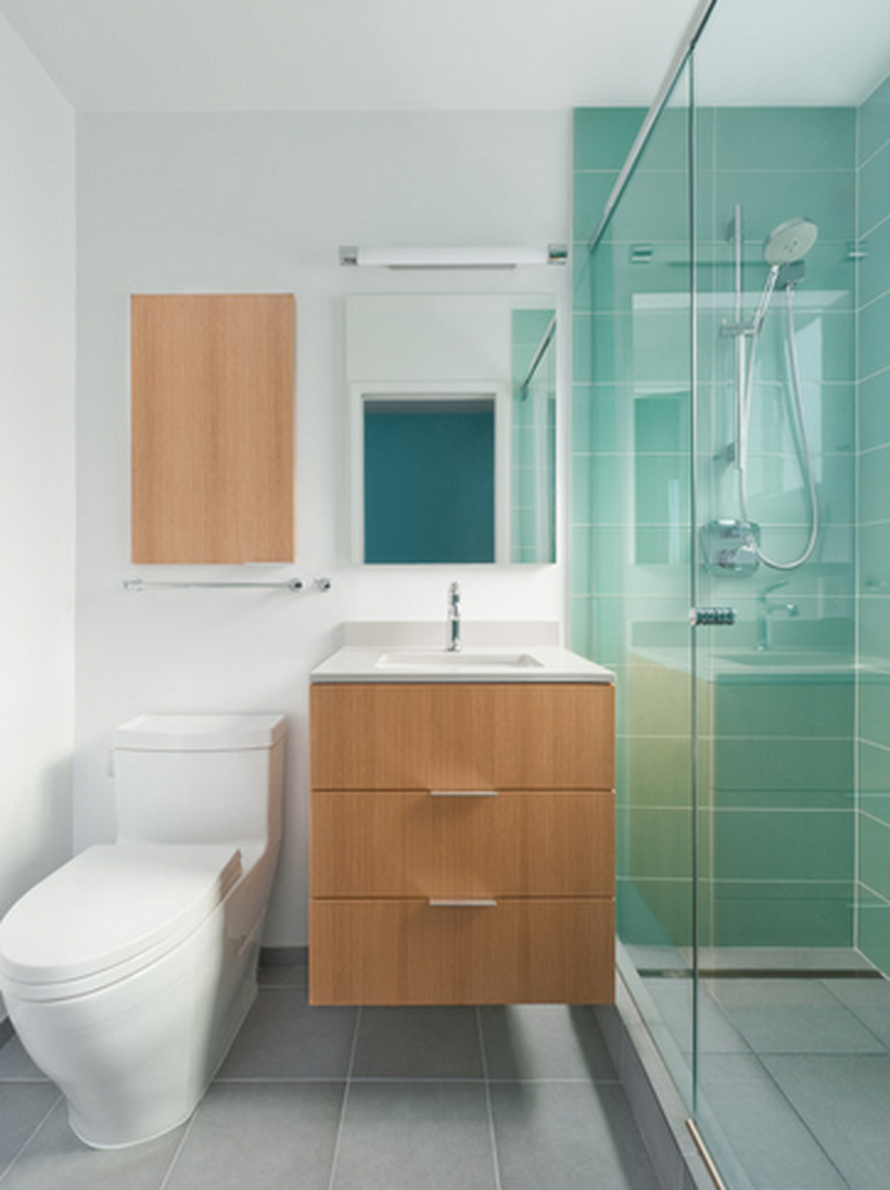 Modern bathroom design with clean shades of blue, towel hooks, a sink and drawers on below, a square mirror