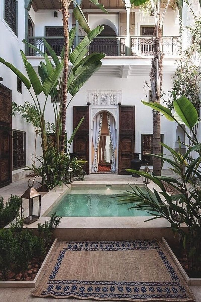 Modern exterior design with small pool, white walls, palm decoration, white curtain on the door to beautify your boho home