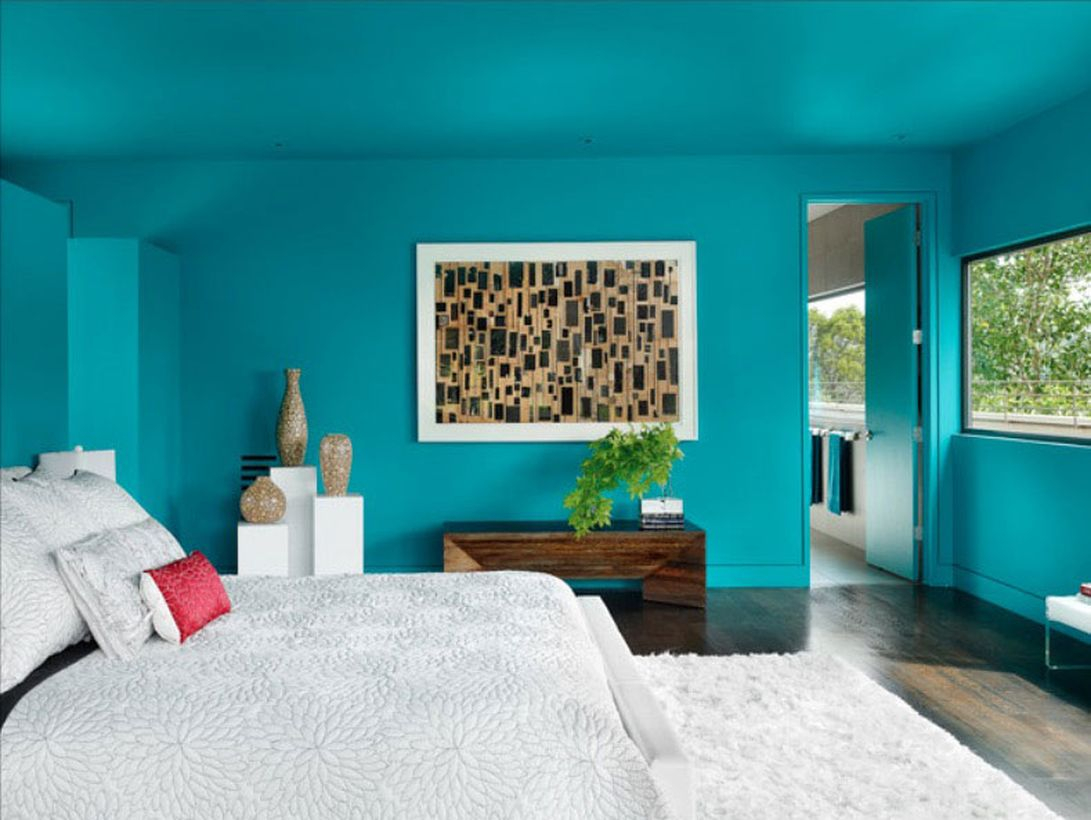 Simple blue bedroom ideas with blue walls, a white bed, white carpet, wooden floors that make the room comfortable